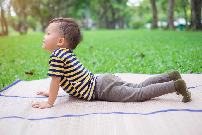 Child in a yoga pose outside