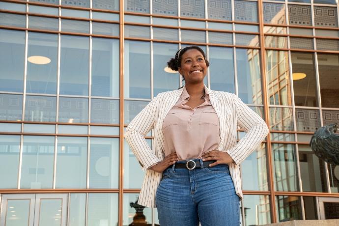 YWCA Minneapolis Afterschool program alumn stands with her