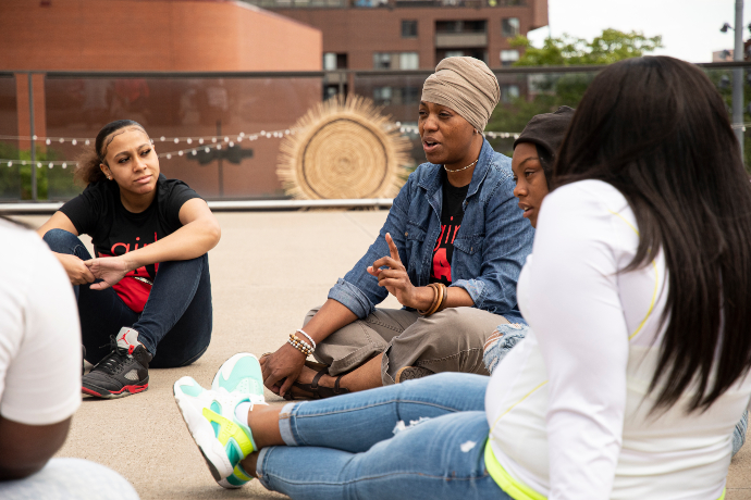 Girls RAP youth sitting in a circle and talking