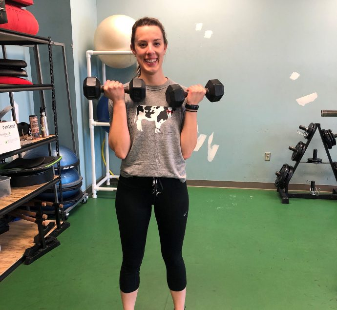 Fitness member lifting weights at the gym