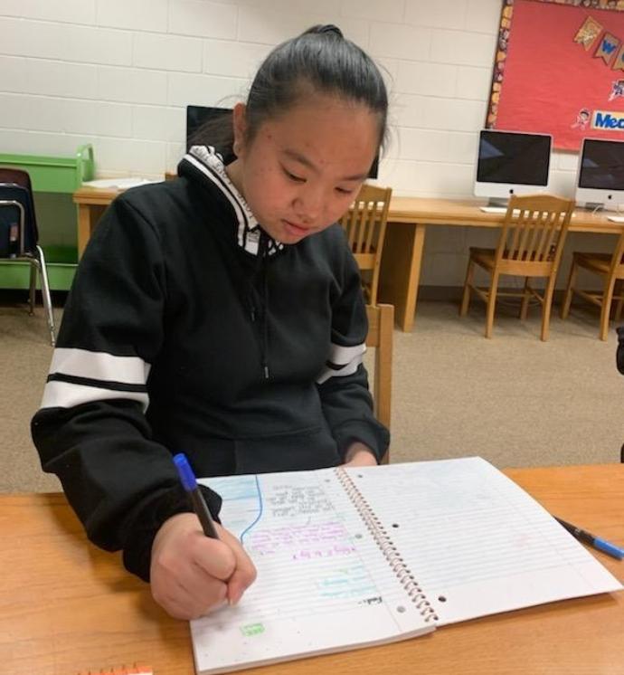 Middle schoolers journaling after school