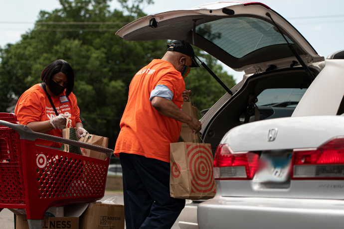 Volunteers load up car with food and supplies at YWCA Midtown